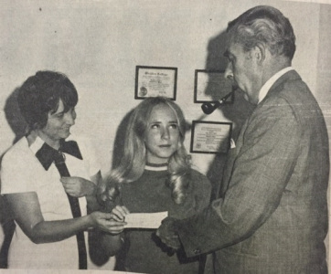 Kathy Knowles accepting a scholarship from president Don White