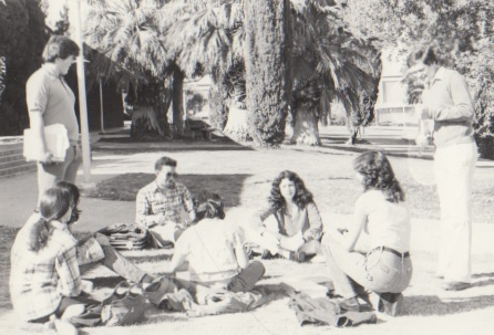70s Students hanging out in a circle in the grass
